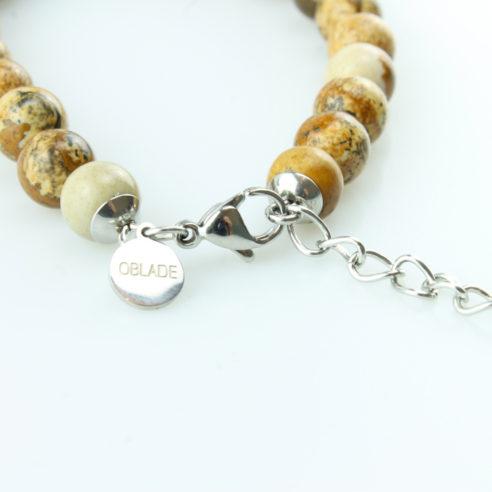 Bracelet pour homme composé de perles de jaspe scénique et de pierres rutile naturelles.