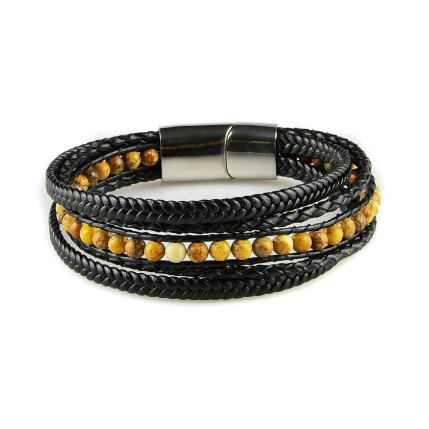 Bracelet pour homme composé de plusieurs lanières de cuir noir lisse et tressé, et de pierres de jaspe scénique.